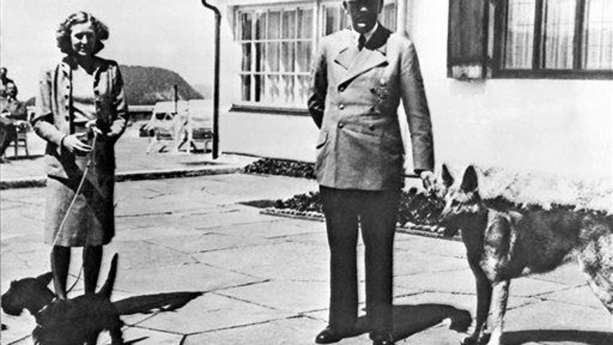 Adolf Hitler and his mistress Eva Braun pose in Berchtesgeden, Germany.