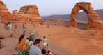 Tourists gather at the Arches National Park in Moab, Utah August 16, 2012. REUTERS/Charles Platiau  (UNITED STATES - Tags: ENVIRONMENT TRAVEL) - RTR38KI2
