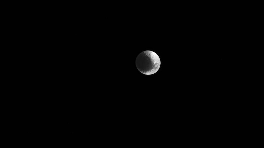 Saturn's unusual moon Iapetus, as captured by the Cassini spacecraft March 11. Features in the image are visible at a scale of about 9 miles (15 kilometers) per pixel.