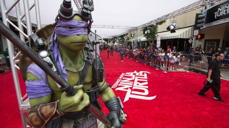 "File photo: A life-size model of the character ""Donatello"" is pictured at the premiere of ""Teenage Mutant Ninja Turtles"" in Los Angeles, California August 3, 2014.  (REUTERS/Mario Anzuoni)"