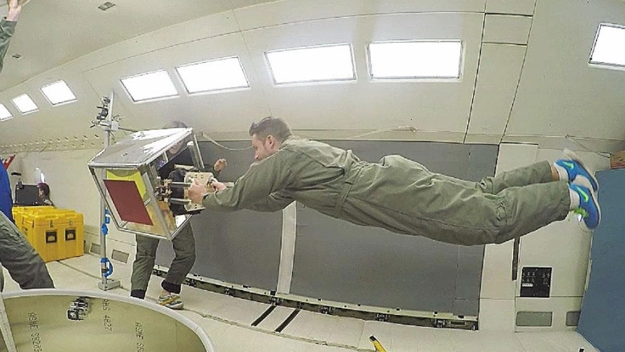 Scientists used a robotic gripper inspired by geckos to move cubes, cylinders and beach balls on the Weightless Wonder, NASA's aircraft that dives to create moments of zero gravity.