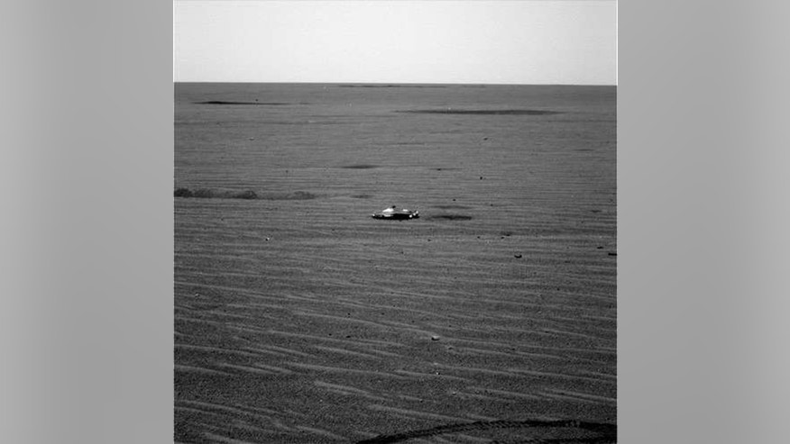Mars Opportunity rover has image of unidentified metallic object, puts internet in a frenzy | Fox News
