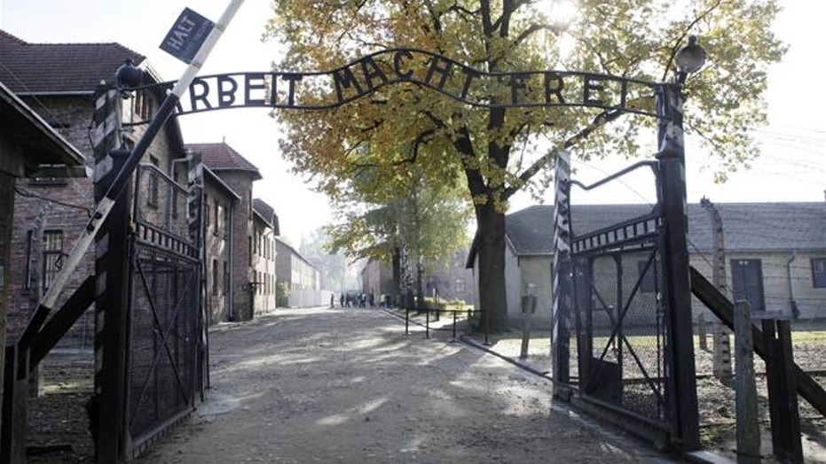 This Oct. 19, 2012, file photo shows the main gate at the former Nazi death camp of Auschwitz in Oswiecim, Poland.
