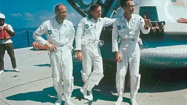 **ADVANCE FOR THURSDAY, JULY 16**  FILE - In this 1969 file photo,  Apollo 11 astronauts stand next to their spacecraft in 1969, from left to right:  Col. Edwin E. Aldrin, lunar module pilot; Neil Armstrong, flight commander; and Lt. Michael Collins, command module pilot.  (AP Photo, file)