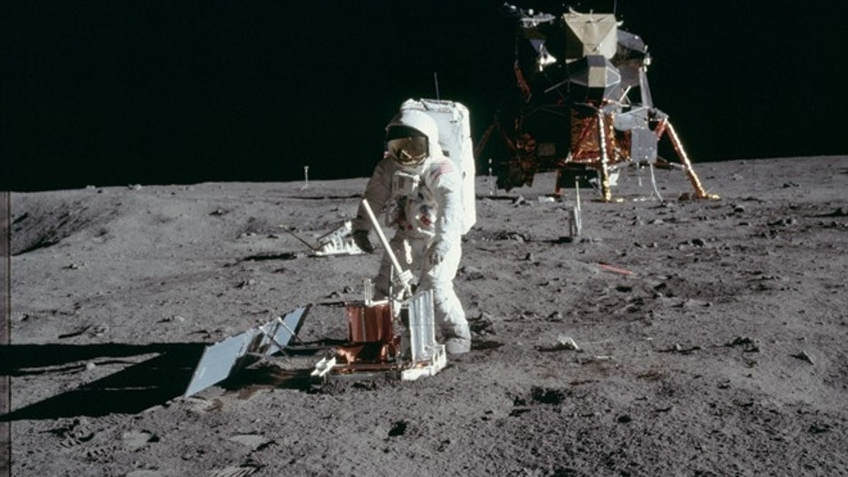 Astronaut Buzz Aldrin deploys a scientific research package on the surface of the moon during the Apollo 11 mission in July 1969. (NASA handout photo via Reuters)