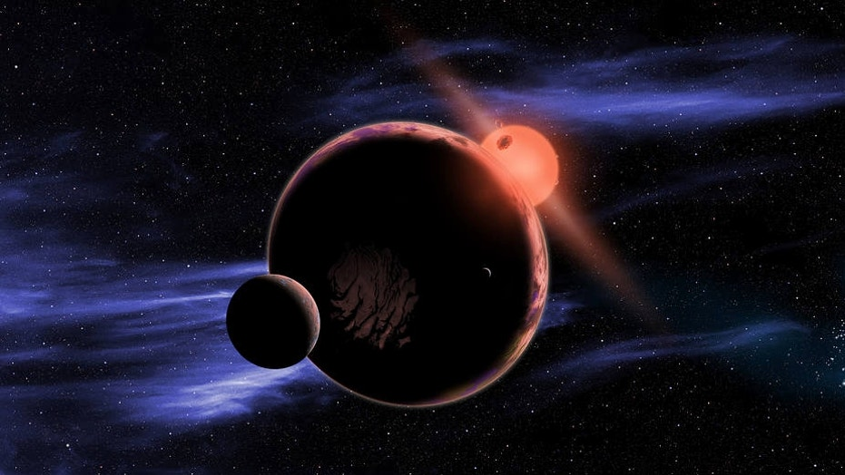 An artist's concept of a red dwarf star with an imagined exoplanet system, where a planet with two moons orbits the habitable zone of the star.