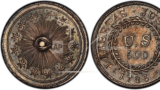 "This image provided by PCGS.com/Professional Coin Grading Service shows the front, left, and back of a 1783 plain obverse Nova Constellatio ""Quint"" silver coin. Authorized by Congress, the coin had a value of 500 units in a proposed but later abandoned early American decimal monetary system that would have ranged from 5 to 1,000 units. (Courtesy of PCGS.com via AP)"