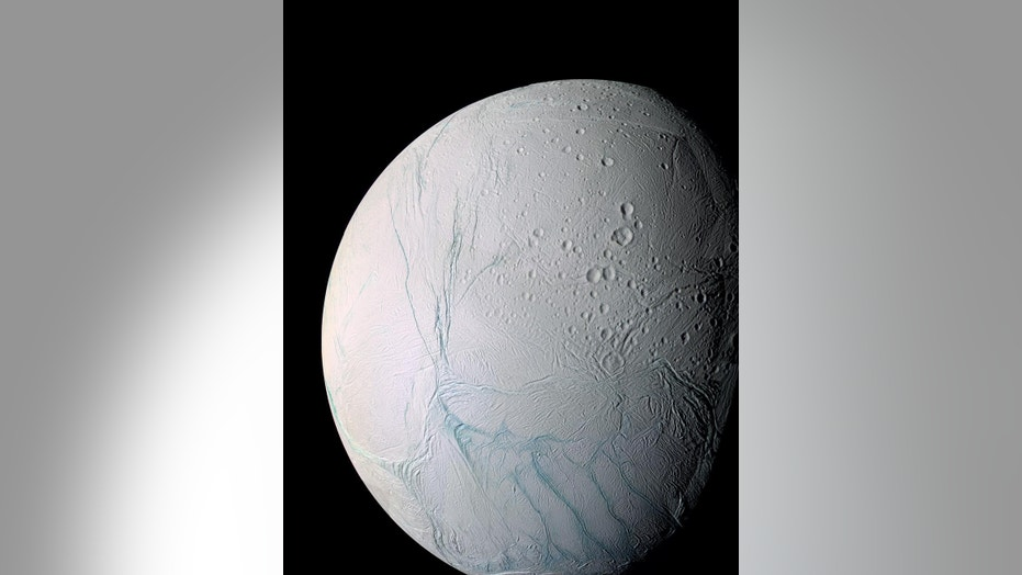 "Observations by NASA's Cassini probe have revealed ""tiger stripe"" features near the south pole of the Saturn moon Enceladus. Water vapor and other materials from the moon's subsurface ocean jet into space from these fractures."
