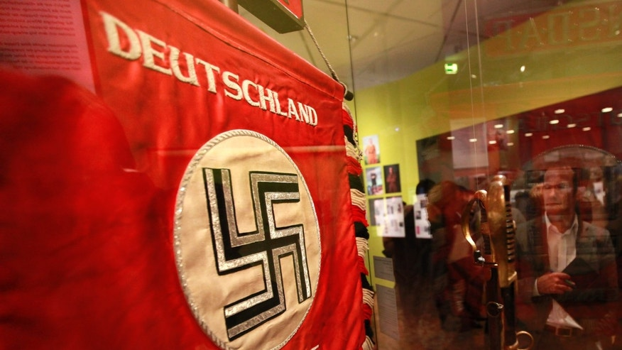 "File photo: A flag with the Nazi swastika is pictured at the media preview of ""Hilter und die Deutsche Volksgemeinschaft und Verbrechen"" (Hitler and the German Nation and Crime) at the Deutsche Historisches Museum (German Historical Museum) in Berlin October 13, 2010. The words on the flag read ""Germany wake up"". (REUTERS/Fabrizio Bensch)"