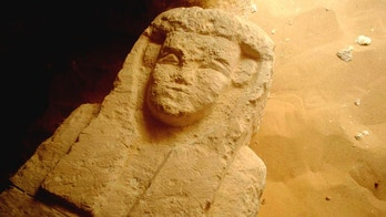 This undated photo released by the Egyptian Ministry of Antiquities shows a sarcophagi in a Ptolemaic tomb in an area known as al-Kamin al-Sahraw, in the Nile Valley province of Minya south of Cairo. Egypt's antiquities ministry says that archaeologists have discovered three tombs dating back more than 2,000 years, from the Ptolemaic Period. (Egyptian Ministry of Antiquities via AP)