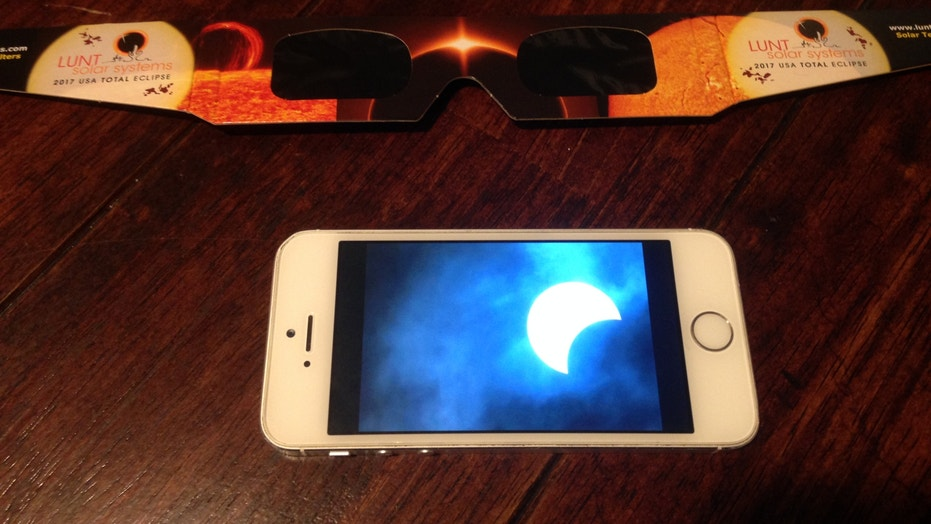 If you want to photograph the sun with your cell phone, consider putting a solar filter over the camera lens to protect the bright image of the sun from becoming burned into the screen.