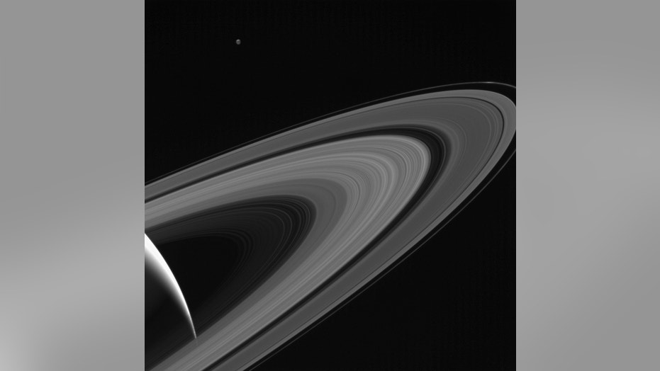 The icy moon Tethys sits above Saturn's rings in this photo captured on May 13, 2017, by NASA's Cassini spacecraft.