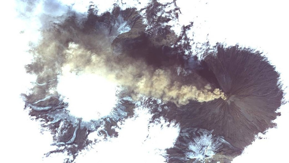 The ASTER satellite captured this vivid view of volcanic activity in Siberia, Russia. The home of these volcanoes is the Kamchatka Peninsula, an area that experiences frequent eruptions due to its location near the Eurasian, North American and Pacific tectonic plates.