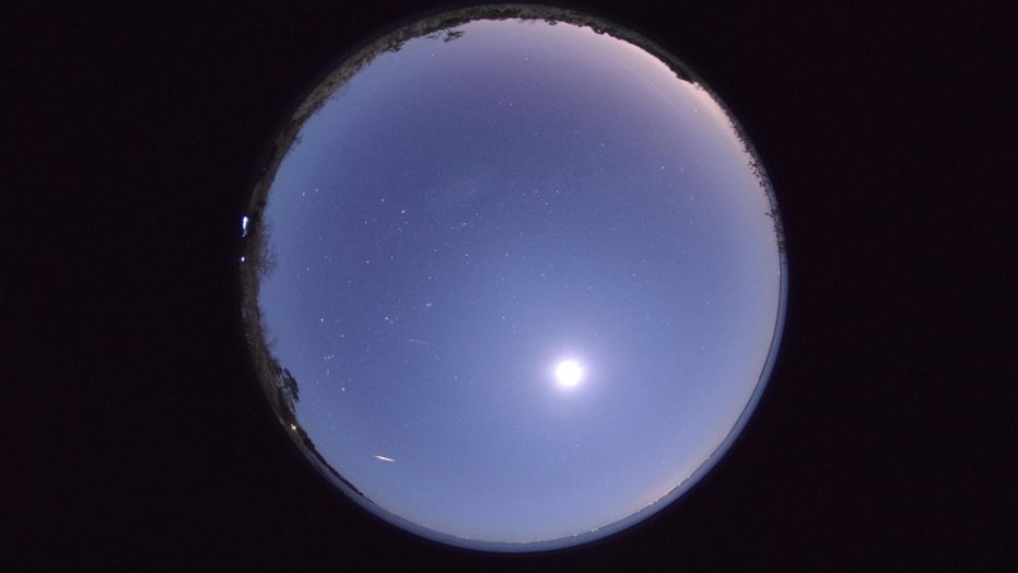 All-sky images taken on Dec. 1, 2014. The central bright spot is the moon. Long lines of light moving up and down are airplanes. Other bright flashes or streaks are meteors.