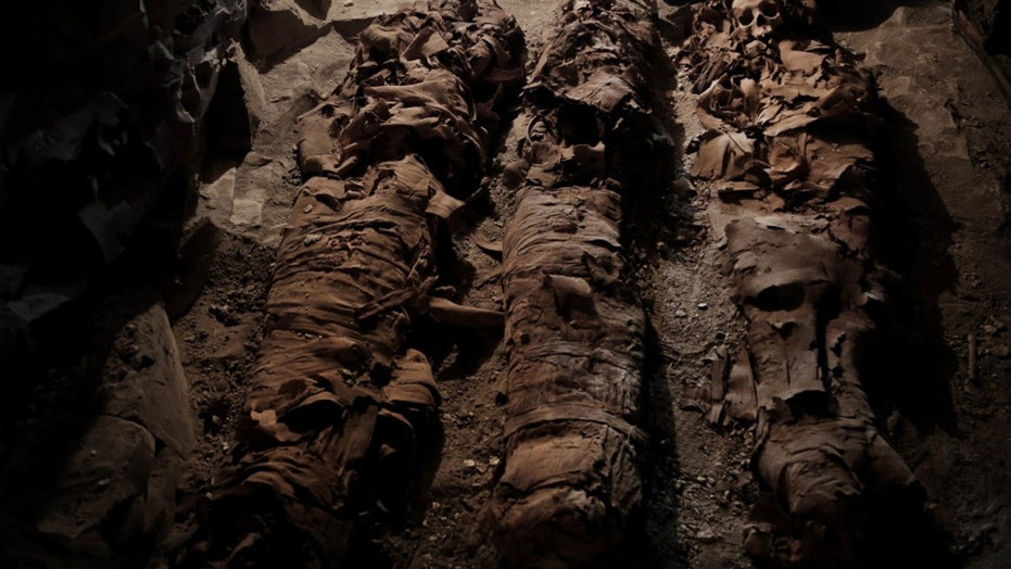 Mummies found in the New Kingdom tomb that belongs to a royal goldsmith in a burial shaft, in Luxor, Egypt. (Credit: Associated Press)