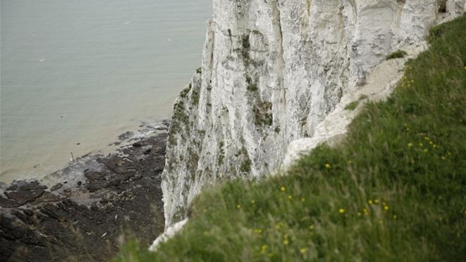 Visitors look down from the top of a section of the White Cliffs of Dover on June 9, 2016.