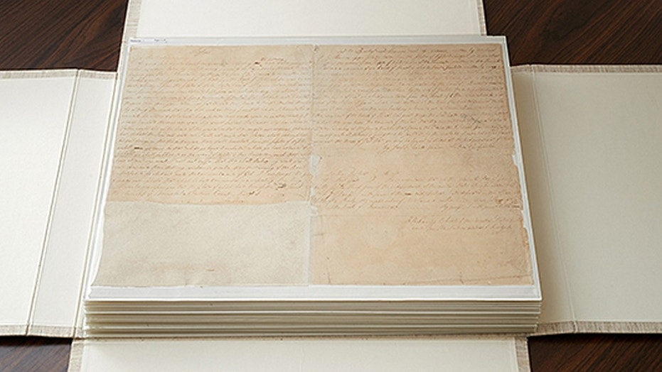 These are the first couple of pages of the printer's manuscript of the Book of Mormon. It is enclosed by folding the casing and then by sliding it into an additional case. (Credit: The Church of Latter Day Saints)