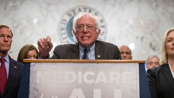 Sen. Bernie Sanders, I-Vt., center, accompanied by Sen. Richard Blumenthal, D-Conn., left, and Sen. Kirsten Gillibrand, D-N.Y., right, speaks at a news conference on Capitol Hill in Washington, Wednesday, Sept. 13, 2017, to unveil their Medicare for All legislation to reform health care. (AP Photo/Andrew Harnik)