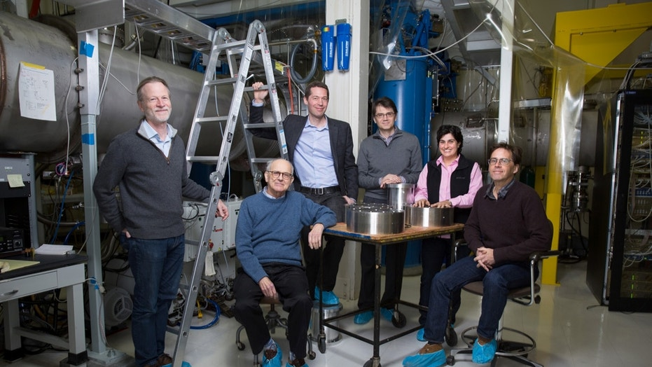 Rainer Weiss (center, seated) poses with members of the MIT LIGO team. Weiss was honored along with Caltech's Barry Barish and Kip Thorne with the 2017 Nobel Prize in physics for detecting gravitational waves.