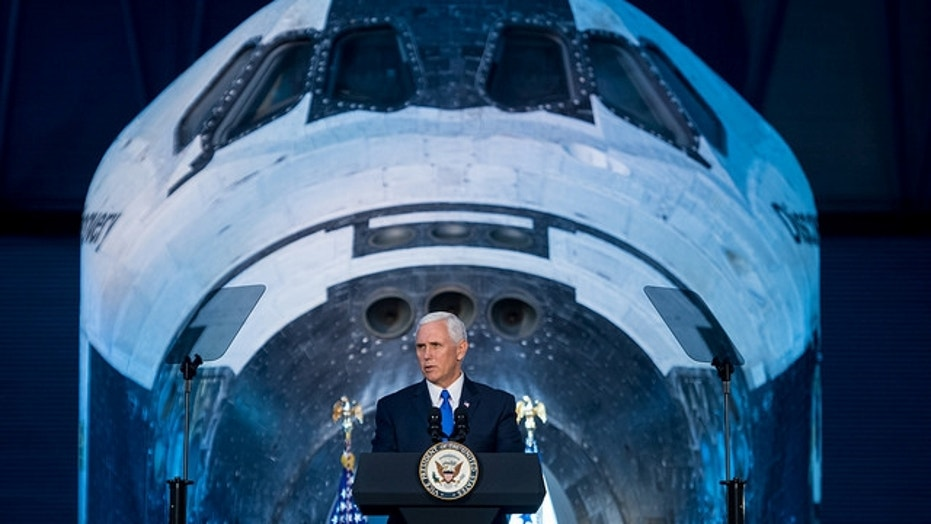 Vice President Mike Pence delivers opening remarks during the National Space Council's first meeting on Oct. 5, 2017 at the Smithsonian National Air and Space Museum's Steven F. Udvar-Hazy Center in Chantilly, Va.