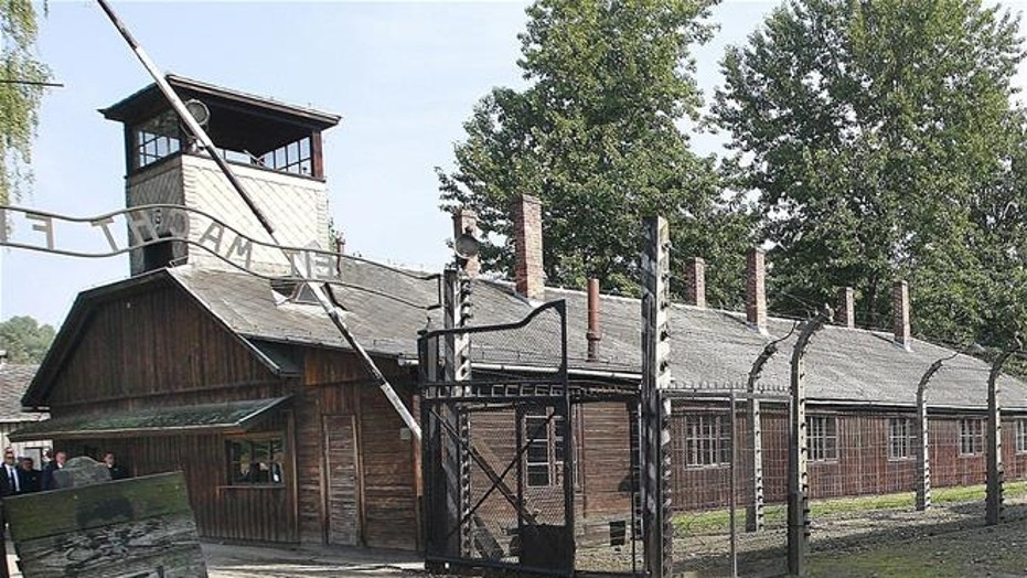 This July 29, 2016 file photo shows the main gate of the former German Nazi death camp of Auschwitz, Poland.