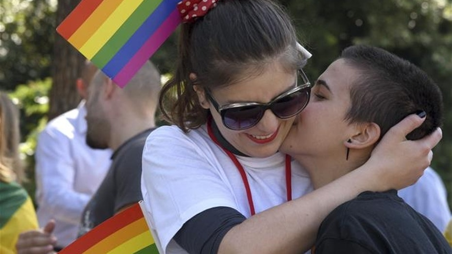 Women kiss during a gay pride march in Podgorica, Montenegro, on Sept. 23, 2017.