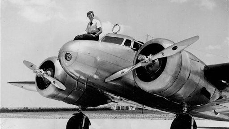 This 1937 photo shows Amelia Earhart before takeoff in Miami for an attempted round-the-world flight.