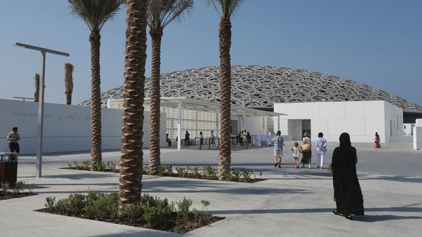 People visit the Louvre Museum, during the public opening day, in Abu Dhabi, United Arab Emirates, Saturday, Nov. 11, 2017. The Louvre Abu Dhabi has opened to the public after a decade-long wait and questions over laborers' conditions working on the project.  (AP Photo/Kamran Jebreili)