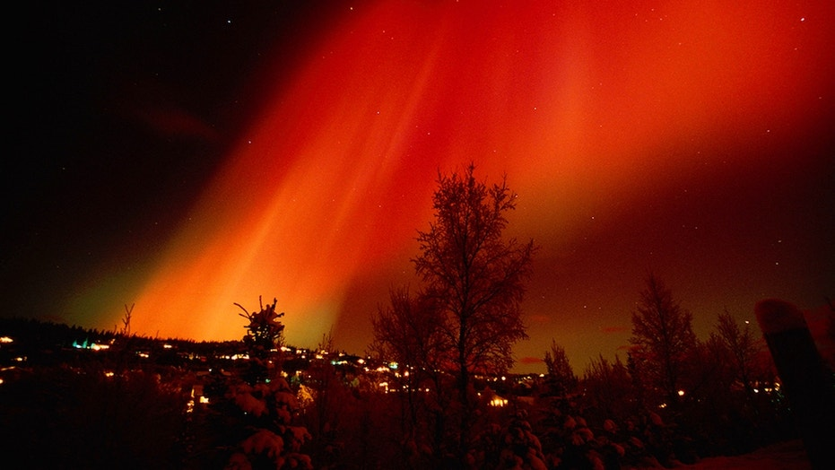 Red Aurora Over Hillside Residence Anchorage, Alaska, from February 2002