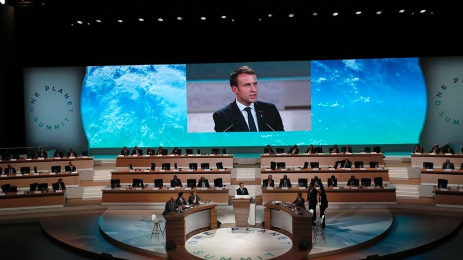 French President Emmanuel Macron delivers a speech at the One Planet Summit, in Boulogne-Billancourt near Paris, France, Tuesday, Dec. 12, 2017. More than 50 world leaders are gathering in Paris for a summit that President Emmanuel Macron hopes gives new momentum to the fight against global warming despite U.S. President Donald Trump's rejection of the Paris climate accord. (AP Photo/Christophe Ena)