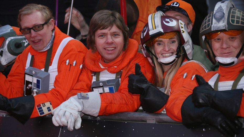 """Star Wars"" fans gather at the film's premiere in London on Tuesday, and soon astronauts get to watch it in space."