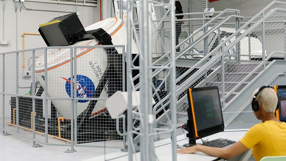 A full motion simulator in the redesigned Astronaut Training Experience (ATX) program.