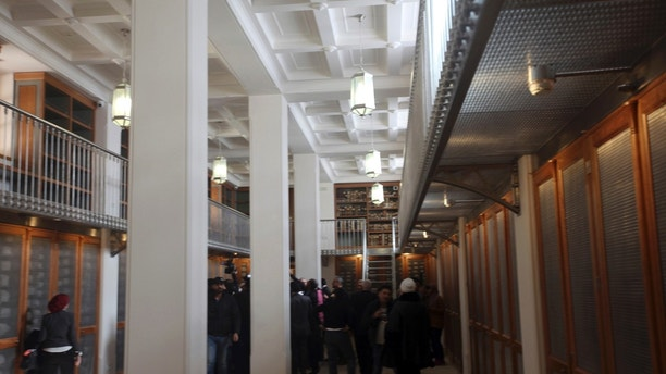 Officials walk around the main hall of the newly opened Saint Cathrine Ancient Library in South Sinai, Egypt on Saturday, Dec. 16, 2017. The inauguration ceremony, attended by Egyptian and western officials, comes after three years of restoration work on the eastern side of the library that houses the world's second largest collection of early codices and manuscripts, outnumbered only by the Vatican Library, according to Monk Damyanos, the monastery's archbishop.  (AP Photo/Samy Magdy)