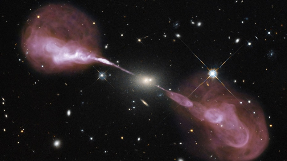 Fountains of hot gas erupting from a beastly black hole in the heart of a large galaxy known to radio astronomers as Hercules A. While astronomers have long seen the fallout of the presence of black holes on the stars and gas clouds around them, none have ever actually stared directly into its abyss.