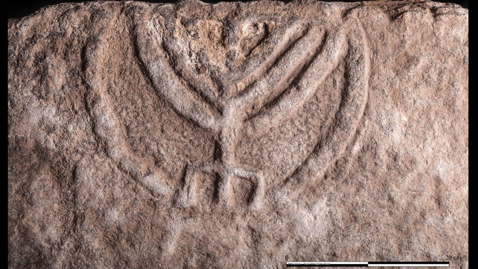 Ancient tomb door with stunning menorah carving revealed