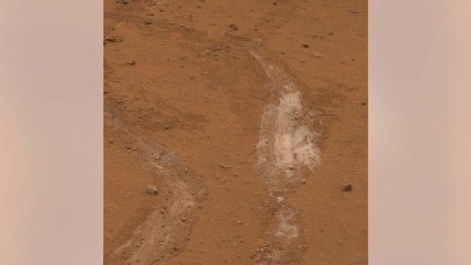 The jammed front wheel of NASA's Spirit rover dug this trench inside Mars' Gusev Crater in 2008. Spirit's observations allowed researchers to determine that the white material is evidence of an ancient hydrothermal system on the Red Planet.
