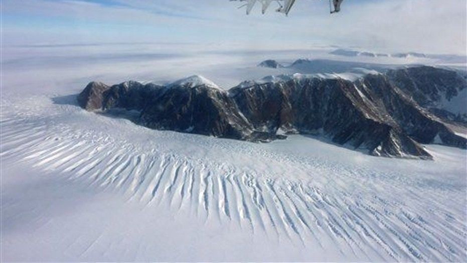 In this photo taken on Nov. 25, 2011, a plane flies over the Transantarctic Mountains.