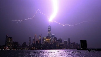 HOBOKEN, NJ - AUGUST 22: Lightning lights up the sky over lower Manhattan as a bolt strikes One World Trade Center in New York City on August 22, 2017 as seen from Hoboken, New Jersey. (Photo by Gary Hershorn/Getty Images)