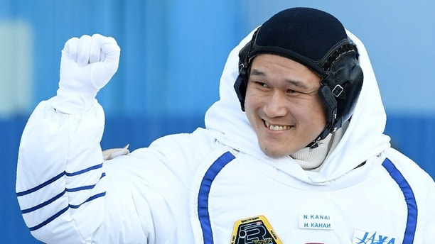 Members of the International Space Station expedition 54/55, Norishige Kanai of the Japan Aerospace Exploration Agency (JAXA) during the send-off ceremony after checking their space suits before the launch of the Soyuz MS-07 spacecraft at the Baikonur cosmodrome, in Kazakhstan, 17 December 2017.  REUTERS/Kirill Kudryavtsev/Pool - RC11BBC6DF70