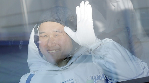 Member of the International Space Station expedition 54/55 Norishige Kanai of the Japan Aerospace Exploration Agency during the send-off ceremony after checking their space suits before the launch of the Soyuz MS-07 spacecraft at the Baikonur cosm