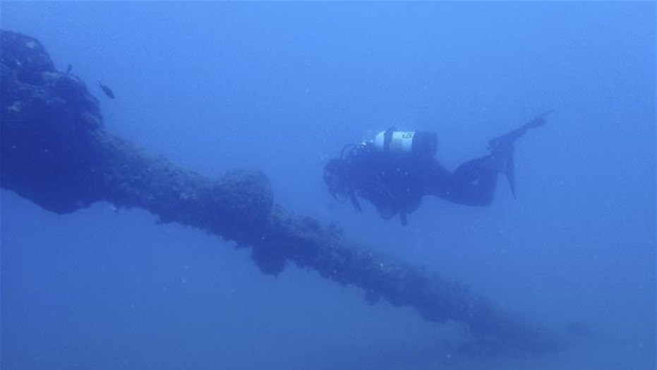 A diver observes the Italian World War II shipwreck MV Probitas in southern Albania.