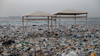 In this Monday Jan. 22, 2018, photo, two tents sit in piles of garbage covering the shore days after an extended storm battered the Mediterranean country at the Zouq Mosbeh costal town north of Beirut, Lebanon. Environmentalists say a winter storm has pushed a wave of trash onto  the Lebanese shore outside Beirut, stirring outrage over a waste management crisis that has choked the country since 2015. (AP Photo/Hussein Malla)