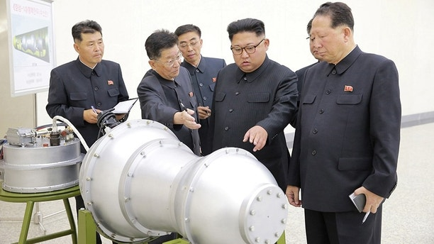 North Korean leader Kim Jong Un provides guidance with Ri Hong Sop (2nd L) and Hong Sung Mu (R) on a nuclear weapons program in this undated photo released by North Korea's Korean Central News Agency (KCNA) in Pyongyang September 3, 2017.  KCNA via REUTERS    ATTENTION EDITORS - THIS PICTURE WAS PROVIDED BY A THIRD PARTY. REUTERS IS UNABLE TO INDEPENDENTLY VERIFY THE AUTHENTICITY, CONTENT, LOCATION OR DATE OF THIS IMAGE.  NOT FOR SALE FOR MARKETING OR ADVERTISING CAMPAIGNS. NO THIRD PARTY SALES. NOT FOR USE BY REUTERS THIRD PARTY DISTRIBUTORS. SOUTH KOREA OUT. NO COMMERCIAL OR EDITORIAL SALES IN SOUTH KOREA. THIS PICTURE IS DISTRIBUTED EXACTLY AS RECEIVED BY REUTERS, AS A SERVICE TO CLIENTS.          TPX IMAGES OF THE DAY - RC18A8521C80