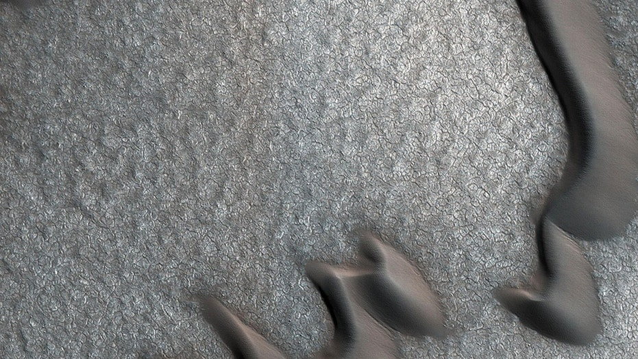 Sand Dunes, Odd Rock Piles Spied by Mars Orbiter