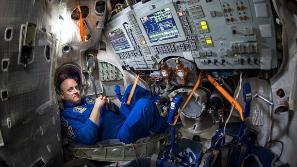 File photo - In this Wednesday, March 4, 2015 photo provided by NASA, astronaut Scott Kelly sits inside a Soyuz simulator at the Gagarin Cosmonaut Training Center (GCTC) in Star City, Russia.