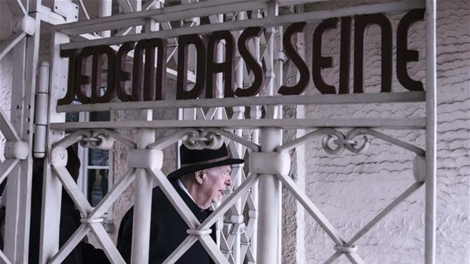 The entrance gate to the concentration camp Buchenwald, with the slogan 'To Each His Own' (Jedem das Seine), is shown in this file photo. Berga was a sub-camp of Buchenwald.