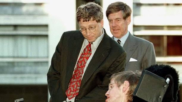 Microsoft President Bill Gates (L), accompanied by University Vice-Chancellor Professor Alec Broers, meets Professor Stephen Hawking on a visit to Cambridge University October 7. Gates, who had earlier in the day met Prime Minister Tony-Blair at Downing Street, is investing 20 million dollars of his personal fortune in a computer research centre at the university. - PBEAHUMPWCT