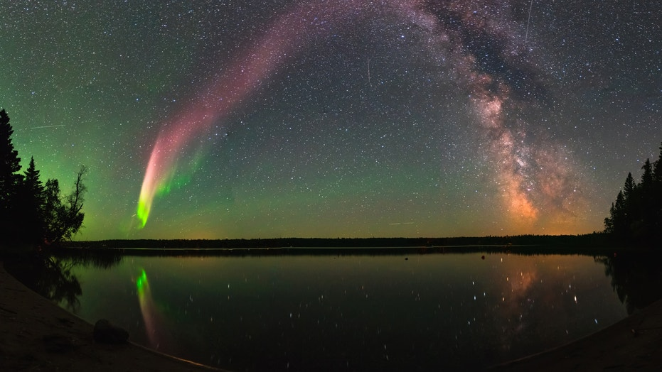 """The majestic aurora-like phenomenon """"Steve,"""" now given the official acronym STEVE, shines with the Milky Way over Childs Lake, Manitoba in Canada."""