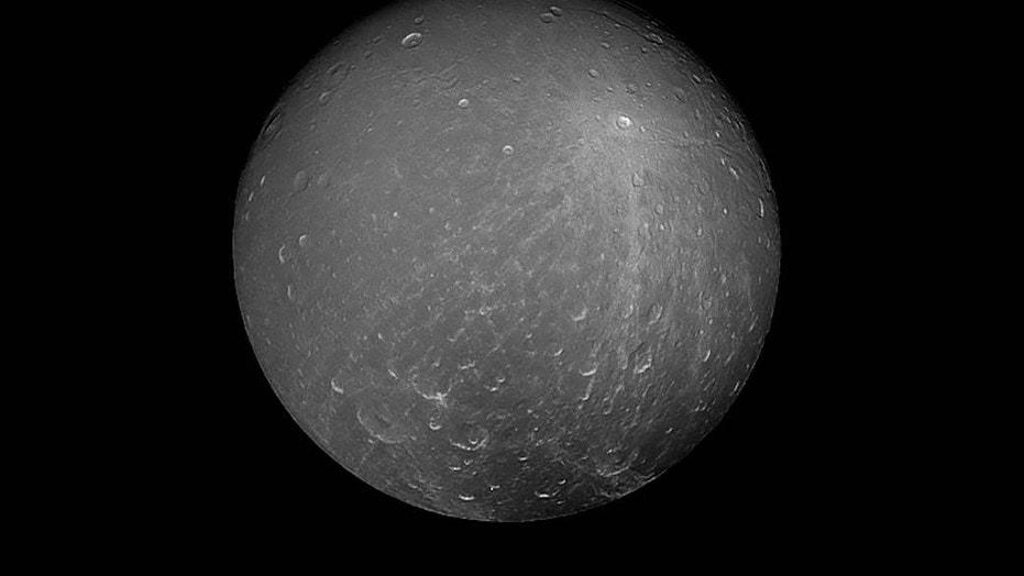 NASA's Cassini spacecraft captured this image of the Saturn moon Dione on July 23, 2012.