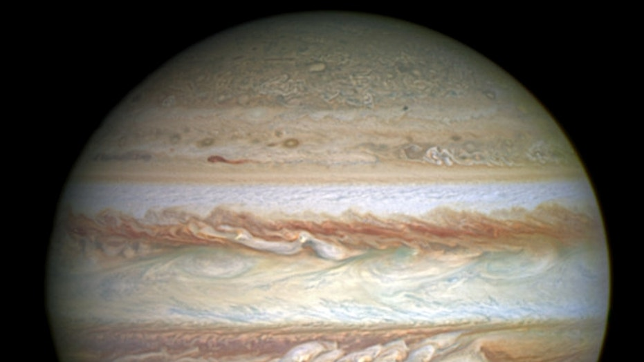Jupiter, with its Great Red Spot churning south of the gas giant's equator.